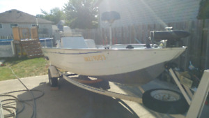 1994 Grumman 16 foot aluminum boat and trailer with 50HP motor