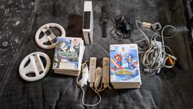 Nintendo Wii Bundle including 2 Wheels, 18 games, 2 controllers, 2 Nun