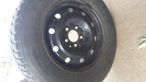 4 marshall snow tires 215/70/15 and new battery