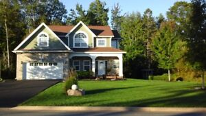 Stone front Executive Home in MacDougall Heights