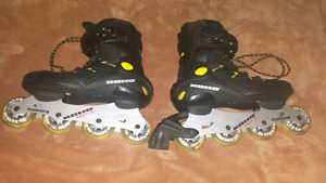 For sale, nice pair of black roller blades koho size  9.