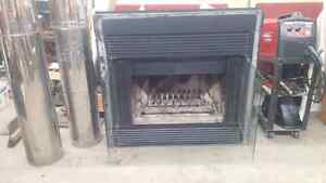 Wood burning fireplace with pipe