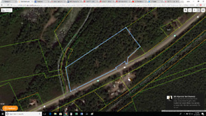 Just under 8 Acres on Highway 7, prime location!