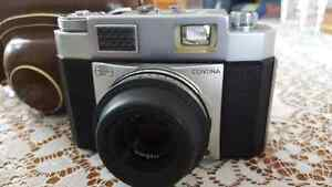 Zeiss Continamatic camera with extra filter and flash