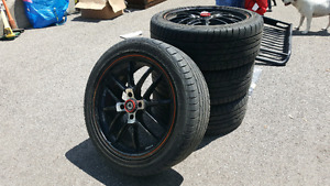 "Konig 17"" rims with tires."