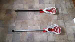 2 lacrosse sticks