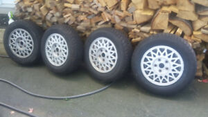 4 like new Mazda 626 Winter tires and alloy rims.
