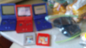 3 gameboy advance and 2 pokemon games 2 chargers