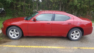 2010 dodge charger v6 red rwd atomatic. as is