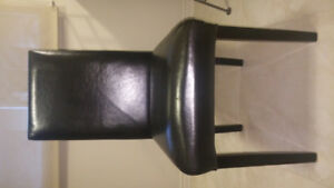 Armless dark brown faux leather dining room/side accent chair
