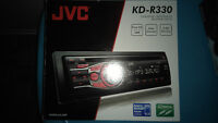 New JVC:  stereo and four 6.5 inch speakers