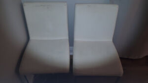 Selling my used white leather chairs
