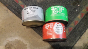 Canisters of propane/butane fuel for camp stove