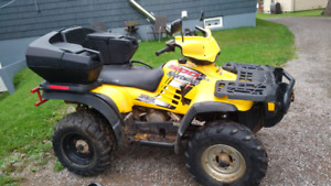 Polaris sportsman 500 ho with back seat and plow     3000 obo