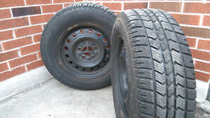 2 Artic Claw tires with rims 215/70R16