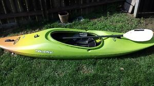 necky white water kayak with paddle and skirt