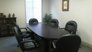 Office conference room table and  6 bonded leather chairs