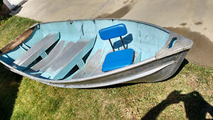 11' fishing boat, 3hp Evinrude, and extras