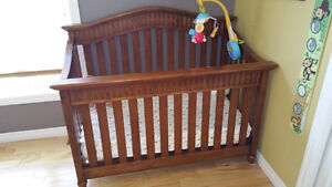 Height adjustable crib and change table