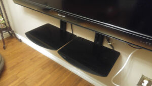 For sale 2 solid dark glass shelves mount on wall under TV