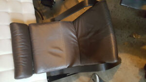 Two Ikea Poang leather armchairs