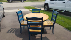 Table and 4chairs and middle extension all wood