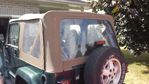 Tan Jeep TJ soft top with door bar and frame Kingston Kingston Area image 2