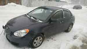 Hyundai Accent 2010 with winter and summer tires and warranty
