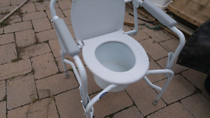 Drop Arm Commode.