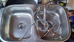Stainless steel sink with Moen faucet working perfectly