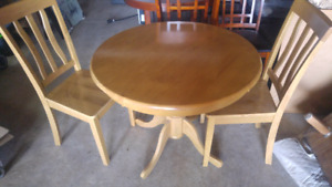 $150.oo. Oak table with 2 chairs ...plus two bar stool