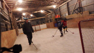 outdoor hockey arena rink glass and puckboard London Ontario image 2