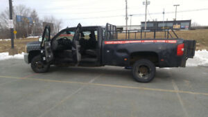 2009 crew cab Chevy Dually with lift gate. Diesel