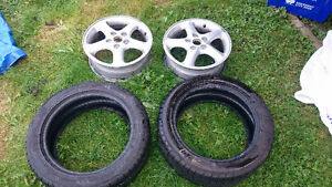 Two 205/50R16 Nokian WR G2 all-weather tires with rims