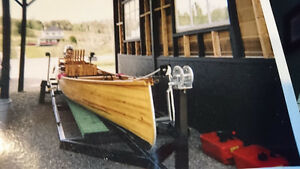 30 ft ribless canoe with motor and trailer