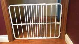 White metal pressure mounted baby gate and pet gate