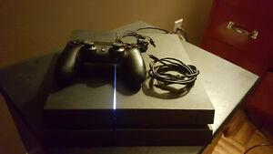 Playstation 4 + manette + 7 jeux 500$