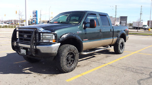 Lifted ford f350 lariat diesel  on 35s
