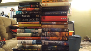 A pile of hardcover fiction