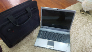 Lap top and travel case bundle.