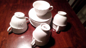 SET OF 7 TEA CUPS AND SAUCERS