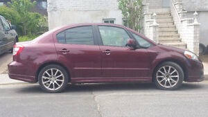2008 Suzuki SX4 sport Sedan (winter tires and rims included)