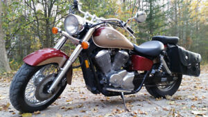 2004 Honda Shadow 750 with low km in great shape .