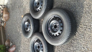 225 70 r16 winter tires. Polar Trax Ironman with rims. $300.00