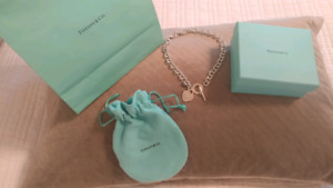 Brand new Tiffany necklace with box and bag.