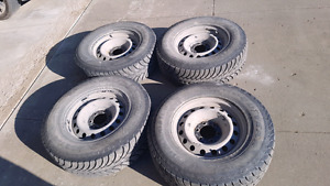 4 Goodyear UltraGrip Ice 265/70R17 tires and rims
