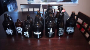 Various empty beer growlers - 750mL, 1L and 2L varieties
