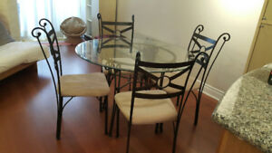 Glass dining table four seater