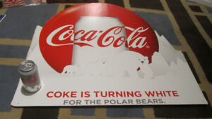 coca-cola coke is turning white for the polar bears sign $60