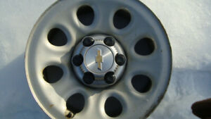 four chev 17 in steel wheels and centers excellent shape